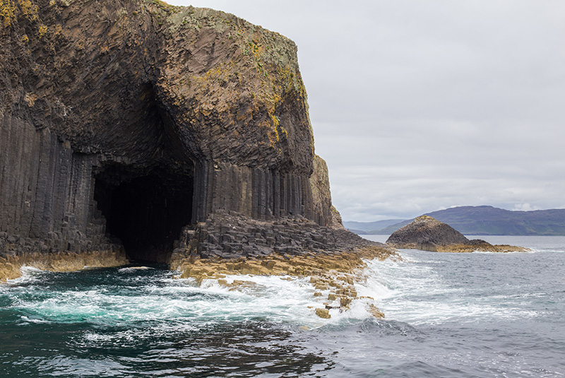Cave entrance under natural cliff of Staffa Island - Tour the sacred sites of Scotland | Sacred Mystical Journeys