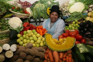 Local woman in fruit and veggie market in Peru - Sacred Tour of Peru & Bolivia | Sacred Mystical Journeys