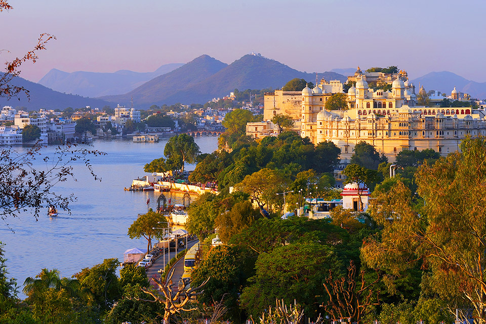 View of Udaipur City with Island and Tourist Boat on Lake Pichola