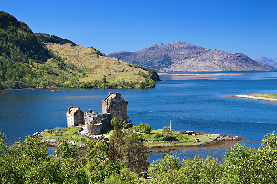 Eilean Donan Castle under a blue sky - Sacred Pilgrimage to Scotland